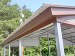Vertical roof trim detail for metal carports, garages, and barns