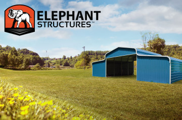 Blue metal barn built by Elephant Barns.
