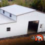 Metal building Ridgeline barn with fully enclosed lean to's and many windows.