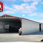 Large commercial metal building with bays and trailers.