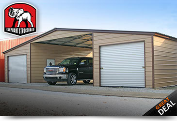 Valley barn with fully enclosed lean-to's, two roll up garage doors and a truck parked in the base structure.