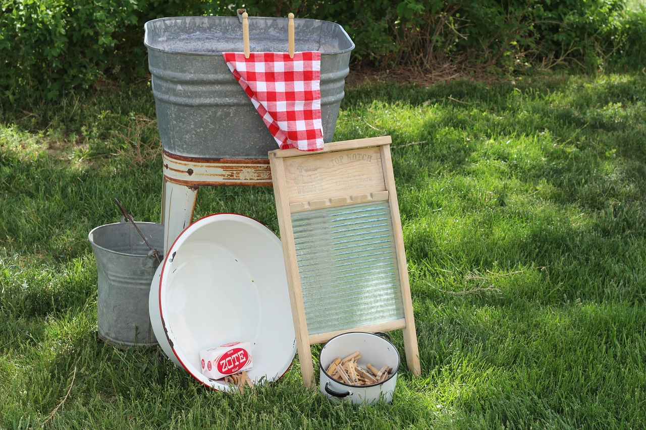 washboard, tub, and clothes line pins